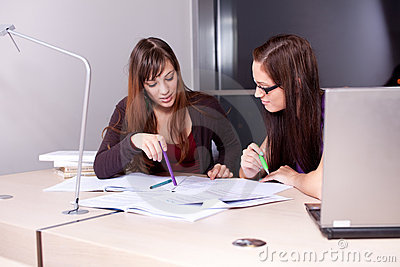 Candid photo of a couple of students studying
