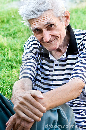 Candid portrait of senior man outdoor