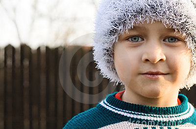 Candid winter portrait of cute kid