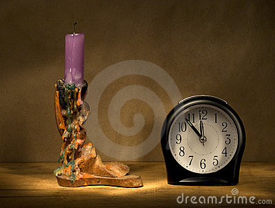 Candle and alarm clock.
