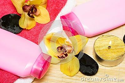 Candle, bottle of shampoo