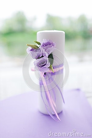Candle decorated with flowers