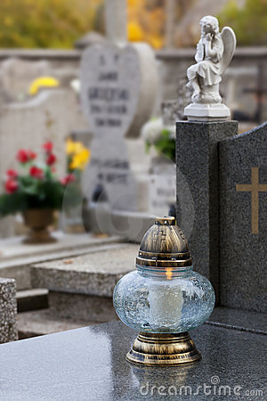 Candle on a gravestone.