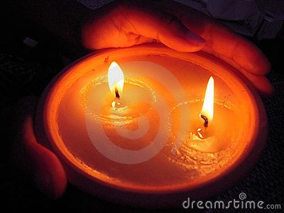 Candle on hands