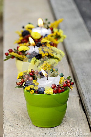 Candle holder with autumn flowers