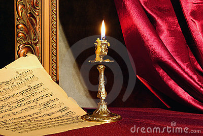 Candle and music sheet