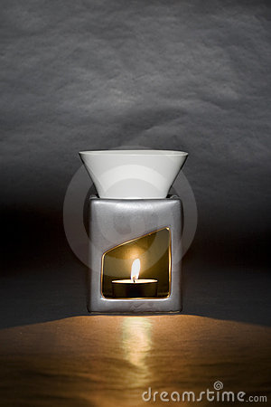 Candle-powered oil burner