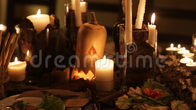 Candle and pumpkins on a table stock footage