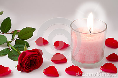 Candle and red rose