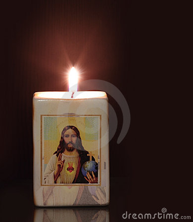 Candle with religion motiff