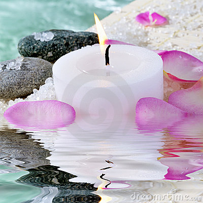 Candle, stones and petals