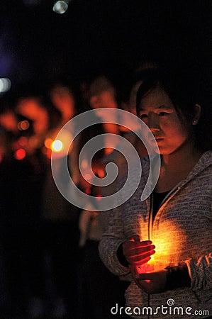 Candlelight prayer Editorial Photo