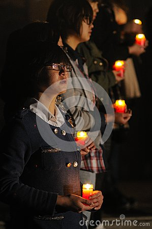 Candlelight prayer Editorial Stock Image