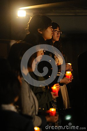 Candlelight prayer Editorial Stock Image