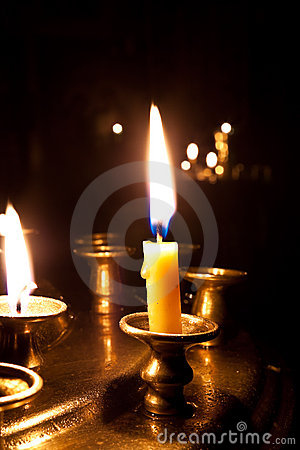Candles  burning in the church.