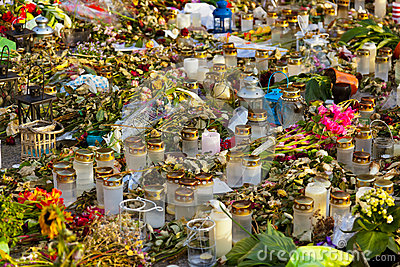 Candles and flowers in cemetery
