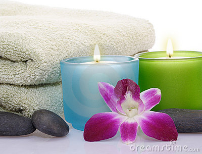 Candles, orchid, pebbles