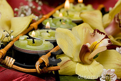 Candles and yellow orchids