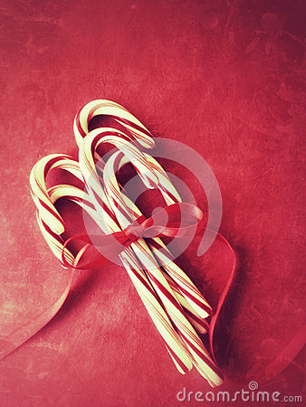 Candy canes with red ribbon