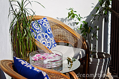 Cane chairs and table on the balcony