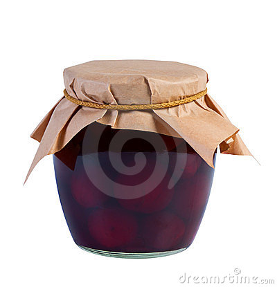 Canned fruit in glass jar on white background.