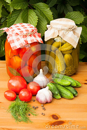Free Canned Tomatoes And Pickled Cucumbers Royalty Free Stock Photography - 79924637