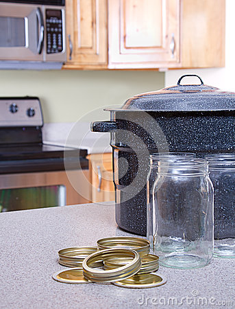 Canning jars and supplies in a kitchen