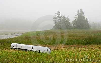 Canoe on inlet in fog