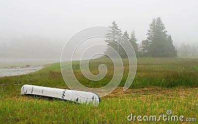 Canoe on inlet in fog