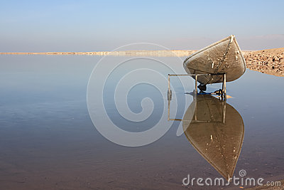 Canoe, reflecting in the mirror of the Dead sea