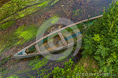 Canoe in shallow river