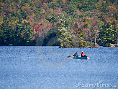 Canoeing on lake in fall