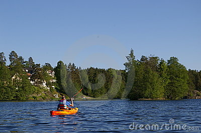 Canoeist on lake