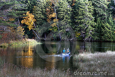 Canoeists on lake