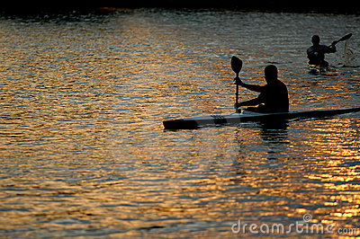 Canoeists paddling on lake