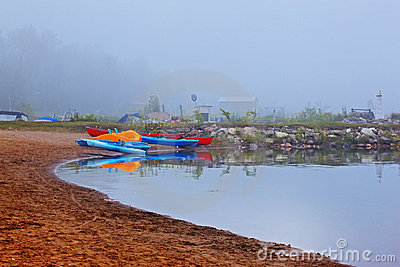 Canoes and kayak in fog