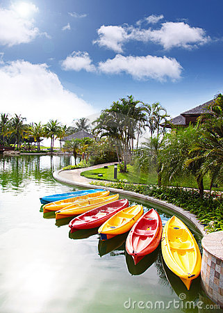 Canoes standby in resorts area, Brunei