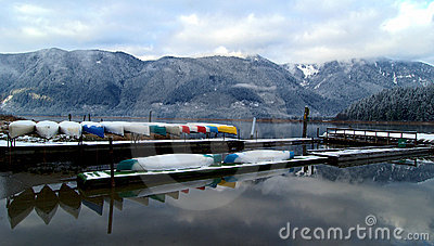 Canoes stored on winter lake