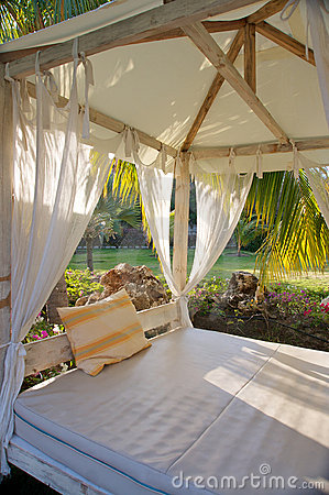 Canopy bed in tropical resort royalty free stock image for Tropical canopy bed
