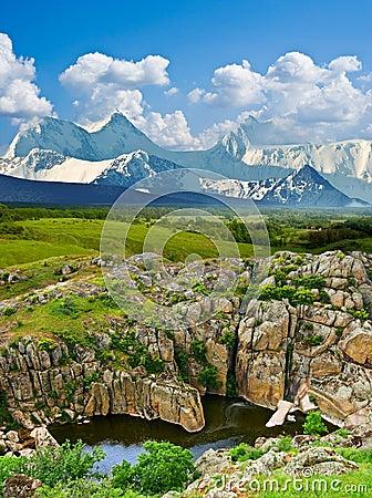 Canyon and a snowbound mountain