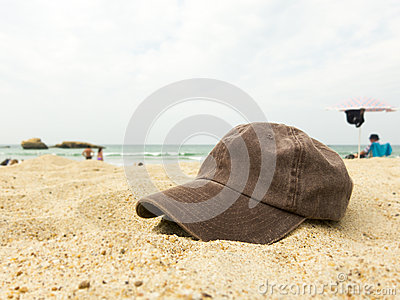Cap on a beach