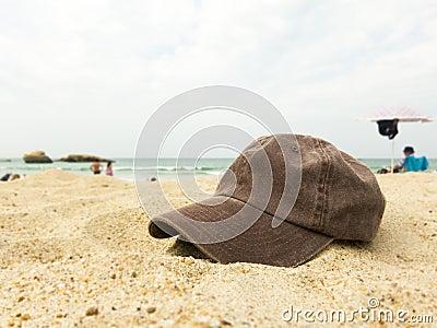 Cap on a beach