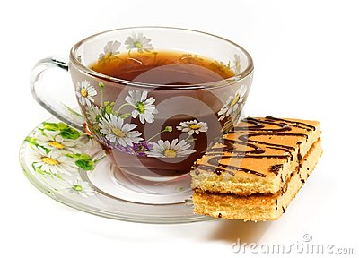 Cap of tea on saucer with cake