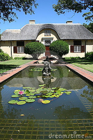 Cape Dutch house behind reflecting pond