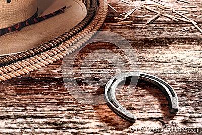 Cappello a ferro di cavallo e Lasso del cowboy ad ovest americano del rodeo