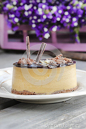 Cappuccino cake on white plate