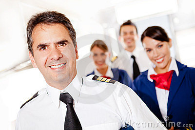 Captain with cabin crew