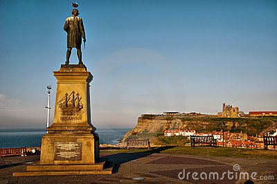 Captain Cook looking over Whitby harbour