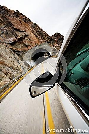 Car approaching tunnel through