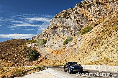 Car in an arid landscape